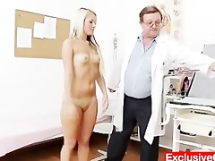 old doctor checks juvenile golden-haired angel